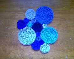 crochet circles in assorted sizes and crochet stitches for some pi day fun
