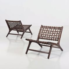Anonymous; Rosewood and Leather Lounge Chairs, c1970.