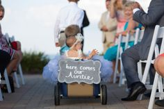Have a groomsman wheel your ring bearer and flower girl down the aisle at your wedding   Photo: AAVA Photography   Infinity and Ovation Yacht Charters
