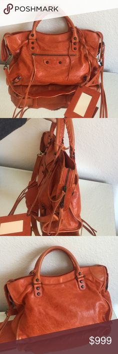 """Authentic Balenciaga bag / orange ❤️ Authentic from my collection.  In good condition.  Some wear at the corners and handles.  Overall a beautiful bag to wear all year around.  The interior is clean.  Comes with a dustbag.   No extra strings.  10 inches tall.  With the handle drop is almost 13.5 ...15"""" wide.  No trades. Balenciaga Bags Shoulder Bags"""