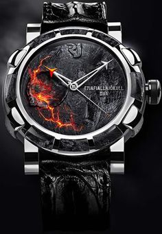 Romain Jerome Eyjafjallajökull DNA Unique Piece -  As if revealed beneath the dial through a bold stylistic effect and ready to burst forth at any moment, the lava ejected from the core of the planet illustrates an inner strength capable of setting fire to time – in this case held captive by a steel bezel and volcanic ash. Conveying memories of fire and lava...