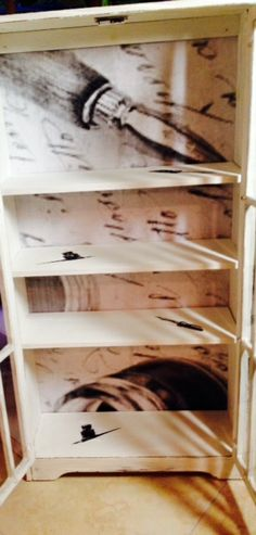 Annie SLoan. /Inside white cabinet with blown up engineering print