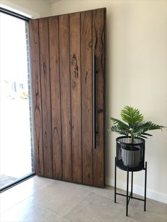 Recycled timber front door, coated in OSMO Tobacco stain. Timber Revival, Melbourne. Made in Melbourne, shipped nationally around Australia. #frontdoor #timberdoor #recycledtimberdoor  #messmate