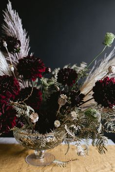A Dark & Moody Halloween Centerpiece DIY for a grown up or adult dinner party for Halloween or Thanksgiving made with pampas grass burgundy dahlias poppy pods and more. Decor Style Home Decor Style Decor Tips Maintenance Halloween Decorations, Christmas Decorations, Holiday Decor, Christmas Tables, Table Decorations, Holiday Centerpieces, Pampas Grass, Do It Yourself Crafts, Paper Crafts