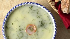 Caldo Verde, a traditional Portuguese soup of potatoes, greens and onions, garnished with a slice of chourico sausage.