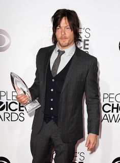 "Despite taking home the People's Choice Award for Favorite Cable TV Drama, Norman Reedus, star of the hit show ""The Walking Dead,"" barely cracked a smile for the cameras at the People's Choice Awards on Jan. 8, 2014."