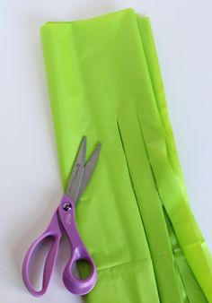 Cutting Plastic tablecloths for hula skirts