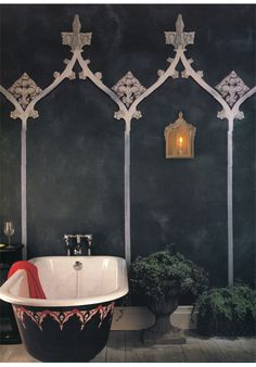 A Gothic inspired bathroom, get the Gothic cupboard furniture to go with: https://originalfeatures.co.uk/ironmongery/fromtheanvil.html