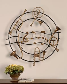 """""""Musical Instruments""""     """"Whimsical in style, this wall decor is made of hand forged metal finished in heavily antiqued silver champagne with matte black details.""""  Designer -Grace Feyock"""