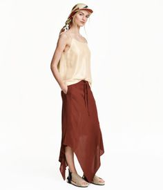 STUDIO COLLECTION. Calf-length skirt in textured, woven viscose fabric. Elasticized drawstring waistband, mock fly, and asymmetric hem. Unlined.