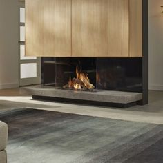 DRU Maestro Eco Wave Balanced Flue Gas Fires are remarkably airy gas fires, differentiated by the most pragmatic firewood demonstration that DRU has ever created, with stunningly lofty and cavernously skipping flames. 3 Sided Fireplace, Corner Gas Fireplace, Home Fireplace, Modern Fireplace, Contemporary Gas Fires, Modern Interior Design, Hearth, Wall Design, Nice Designs