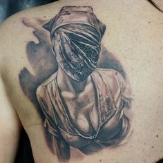 Horror lovers get Silent Hill tattoos! By Bryan Merck.