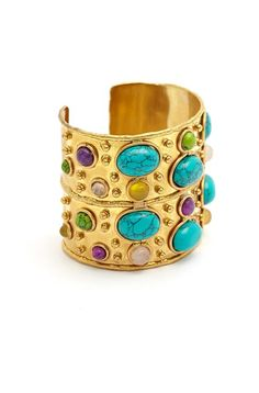 We love this brass and turquoise cuff by Sylvia Toledano.