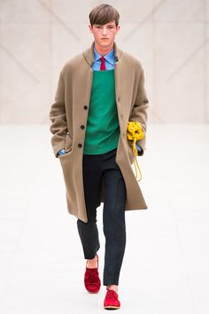 "Christopher Bailey presented his Spring/Summer 2014 collection for Burberry Prorsum during London Collections: Men, after a decade in Milan. Entitled ""Writers and Painters"" the collection featured relaxed and youthful looks and lots of color."