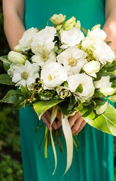 Simple green and white bouquet, with white anenomes and lisianthus with teal dress. Wedding flowers by London based Floral designers Okishima & Simmonds. www.okishimasimmonds.com