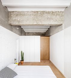 This Double-Height Apartment in Barcelona Features Historic Details and a Floating Staircase - Photo 7 of 12 - Garage Bedroom, Basement Bedrooms, Bedroom Bed, Bedroom Ideas, Basement Ideas, Rue Verte, Floating Staircase, Modern Garage, Bedroom Lighting