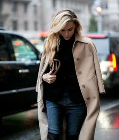 Very classic all American look the camel coat black turtleneck and jeans
