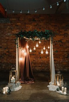 Industrial Chic Wedding Ceremony Arch Ideas A moody industrial wedding ceremony structure with greenery and hanging globe lights. Here are 6 Ideas for your Industrial Wedding Arch from Here Comes The Guide!