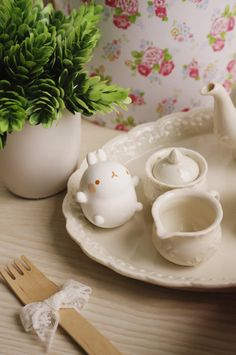 I don't know what that is, but it's cute and having tea.