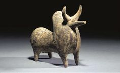AN AMLASH TERRACOTTA BULL RHYTON  10TH-8TH CENTURY B.C.  The hollow vessel with large rump and prominent neck hump, the muzzle extending int... CHRISTIE'S Price Realized   £9,988 (Set Currency) ($16,030) SALE 9599 — 13 May 2003 London, South Kensington