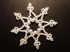 Ein traumhaft schöner,  filigraner Perlenstern von mir selbst  in liebevoller Handarbeit  gefertigt. ...