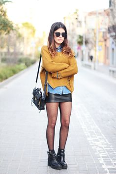 not a fan of the boots, but i love the interesting tights, and the contrast of colors/styles/textures up top