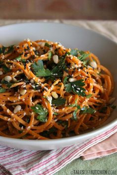 The bestest carrot pasta! Served with a creamy, zesty garlic sauce, lots of parsley, sesame seeds and pine nuts. {raw & vegan}