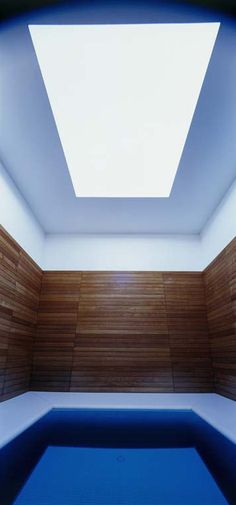 Stone Sky, infinity pool. Turrell's installation brings a square of sky through an overhead plane. By swimming underwater at the end of the pool, one surfaces within a cube-like Skyspace, whose interior is finished in teak. 2007. Napa Valley.