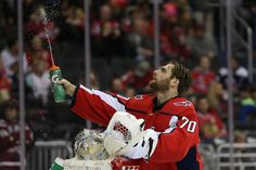 WASHINGTON, DC - NOVEMBER Goalie Braden Holtby of the Washington Capitals sprays his water bottle before playing against the Chicago Blackhawks at Capital One Arena on November 2018 in Washington, DC. (Photo by Will Newton/Getty Images) Washington Capitals Hockey, Washington Dc, Hockey Teams, Ice Hockey, Goalie Pads, Braden Holtby, Nhl Games, Chicago Blackhawks, Voodoo