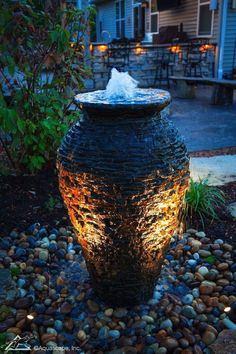 Be creative with your garden lighting options and you'll find you enjoy your water feature during the evening hours just as much as you appreciate it during the daytime. Backyard Water Fountains, Diy Water Fountain, Waterfall Fountain, Fountain Lights, Fountain Garden, Fountain Ideas, Small Fountains, Large Water Features, Outdoor Water Features