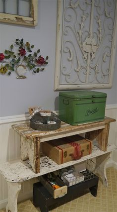 Displaying Vintage Finds - stacked chippy benches are a clever way to display collections - via Chateau Chic
