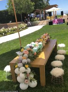 Seated: Kim shared photos of the tables too, which were short enough for kids and stocked with balloons and flowers