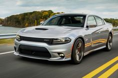 2015 Dodge Charger SRT® 392. The 6.4-liter HEMI® V8 engine produces 485 horsepower
