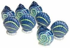 """Pfaltzgraff Ocean Breeze Mini Salt and Pepper Shakers, Set of 4 by Pfaltzgraff. $30.00. Made of earthenware with plastic plugs for refilling. 3-year warranty. Sculpted seashell shapes detailed in blues and greens. 4 sets of mini salt and pepper shakers in the popular Ocean Breeze pattern. Hand-wash. Amazon.com                Dinner conversations flow without """"please pass the salt"""" interruptions when guests enjoy their own individual set of mini salt and pepper shakers. This b..."""