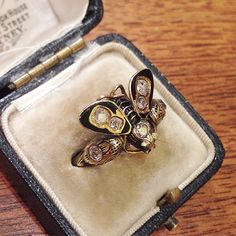 A Victorian Enamel, Diamond and Gold Insect and Serpent Ring, c.1880