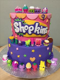 Shopkins cake - bottom layers chocolate, top layers vanilla both with cherry filling, buttercream icing and fondant designs