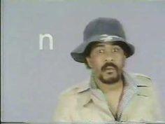 Freaky.. All I can think about is ep103 of Black Dynomite.  Classic Sesame Street - Richard Pryor's alphabet