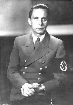 Joseph Goebbels in Nazi Party armband and badge.  Short, dark-haired, dark-eyed, and club footed, Goebbels was far from the Aryan ideal by which he judged so many human beings unworthy of life.  He was, however, a gifted propagandist and orator, being second only to Hitler as the Nazi Party's public speaker.