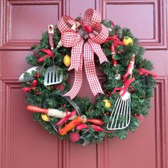 Vintage Red Kitchen Utensil Christmas / Holiday Wreath. Faux greenery with holly, wood handled utensils, sugared fruit and gingham bow.