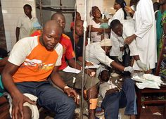 Injured people are treated by health workers at a hospital, after multiple explosions occurred at a munitions depot, in Brazzaville, Republic of Congo, Sunday, March 4, 2012. Blasts rocked the capital of the Republic of Congo Sunday morning after a weapons depot caught fire, officials said, killing more than 200, wounding unknown numbers, and forcing some 2,000 people to flee their homes.(AP Photo/Elie Mbena)