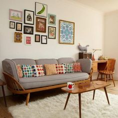 Image result for mid century room blue sofa red rug