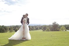 Bride & Groom overlooking the golf course at Riverside Country Club