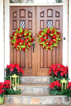 Bright red and lime green double wreaths with poinsettias and the lime green lanterns by Top This Top That