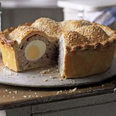 Scotch Egg Pie Recipe with eggs, sausages, mace, thyme, bread crumbs, shortcrust pastry, flour for dusting, sesame seeds