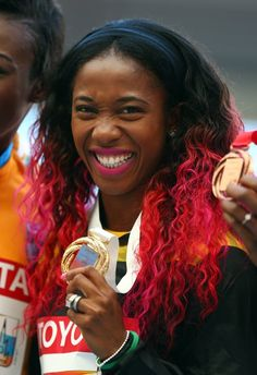 Gold medalist Shelly-Ann Fraser-Pryce of Jamaica poses on the podium for the Women's 200 metres during Day Eight of the 14th IAAF World Athletics Championships Moscow 2013 at Luzhniki Stadium on August 17, 2013 in Moscow, Russia. (Photo by Paul Gilham/Getty Images)