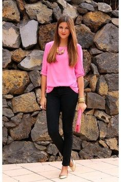 Hot pink silk shirt, black slacks, gold flats, hot pink clutch, and gold statement jewelry.
