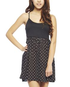"""This sweet tank features a solid ponte knit top with scoop neck, spaghetti straps, and a caged back giving it a little bit of edginess. The attached skater skirt has a polka dot printed woven body with an elasticized waist.   Model is 5'9"""" and wears a size small      Self: 100% Polyester - Contrast: 85% Polyester / 12% Rayon / 3% Spandex     Hand Wash     USA"""
