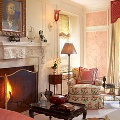 A lovely #Valentine of a room by @letaaustinfoster.  #Handpainted pink wall coverings from @graciestudio, #bowoodchintz from @colefaxandfowler, #Staffordshiredogs, and a roaring fire... Just a few of my favorite things!  #happyvalentinesday