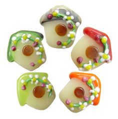 Multicoloured birdhouse lampwork beads
