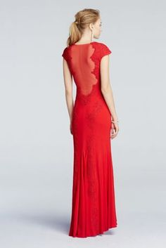 Red hot and regal with classically sexy details, this lace dress will have everyone's eyes on you at this year's Prom!  This beautiful floor length dress features a cap sleeve bodice, complete with gorgeous lace applique detail that extends into godets for an ultra-flattering, streamlined silhouette.  Eye-catching v-neckline and illusion back add plenty of allure for an elevated Prom look.  Designed by Betsy & Adam.  Fully lined. Imported. Side seam zipper.  Professional spot clean only.